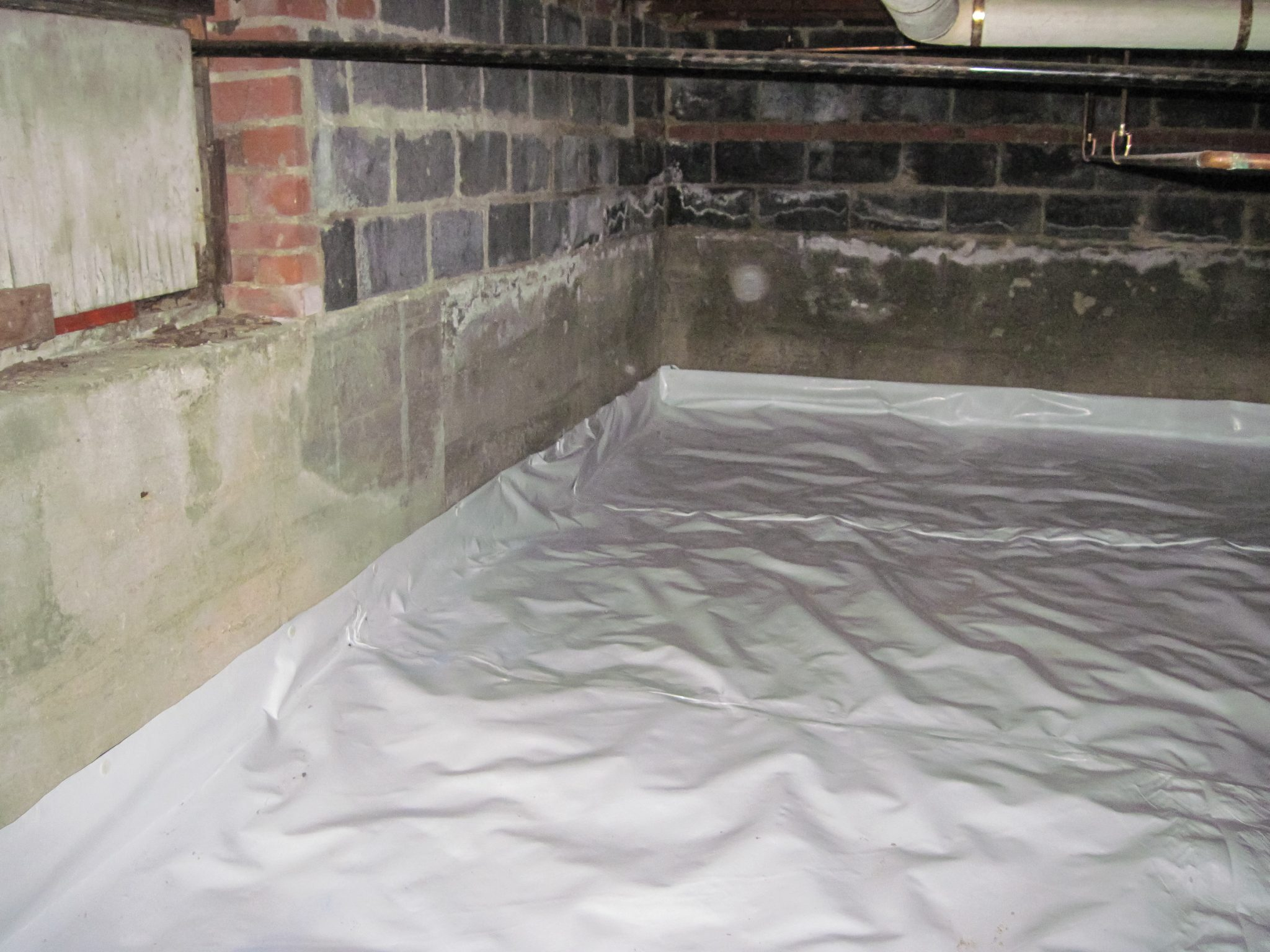 4 major reasons for your crawl space leaking in flint mi for Concrete crawl space floor